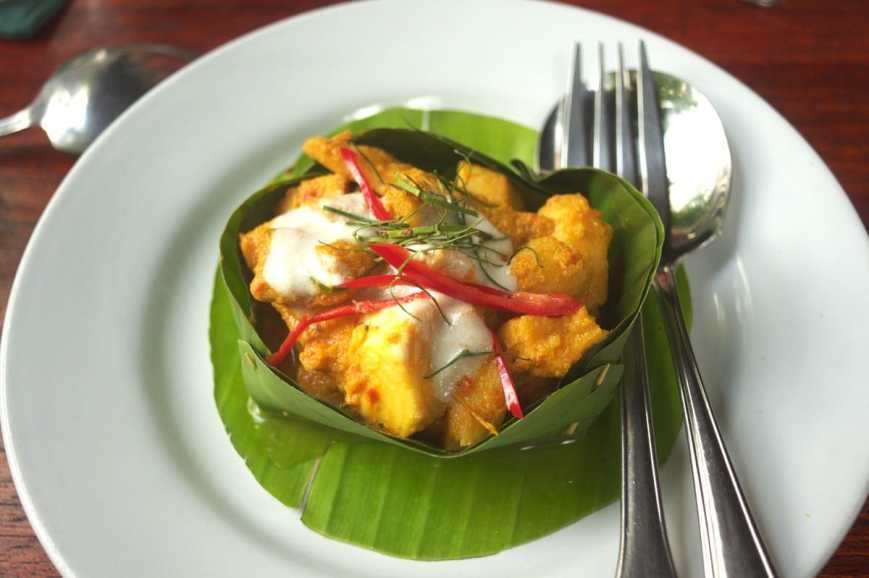 Traditional Khmere Fish Amok served in a banana leaf and topped with red peppers