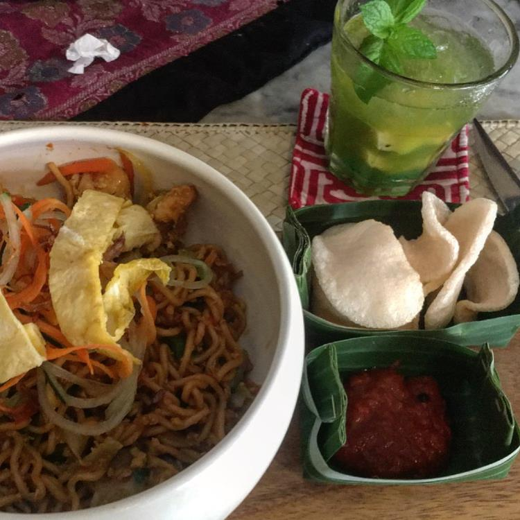 Balinese Mie Goreng served with a side of shrimp chips and spicy sambal