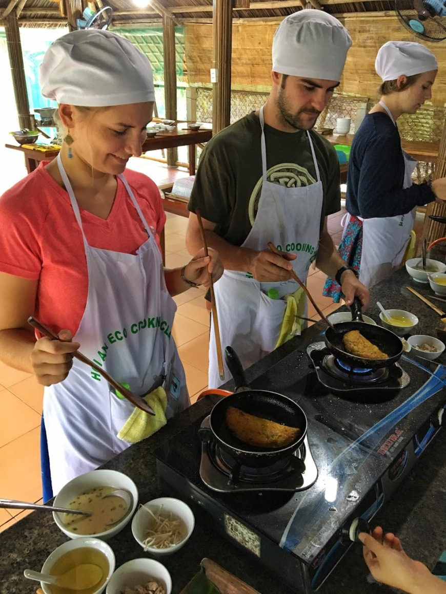 Travel Couple Cooking Banh Xeo At A Cooking Class in Hoi An Vietnam