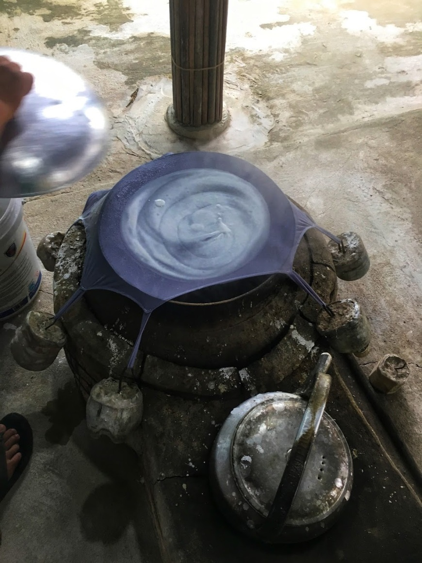 Traditional method of making rice paper with fabric stretched over pot of boiling water