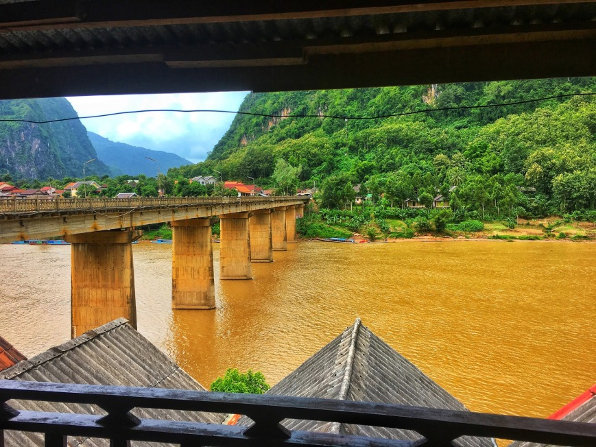 View from balcony of guesthouse overlooking the Nam Ou River and bridge through town in Nong Khiaw Laos