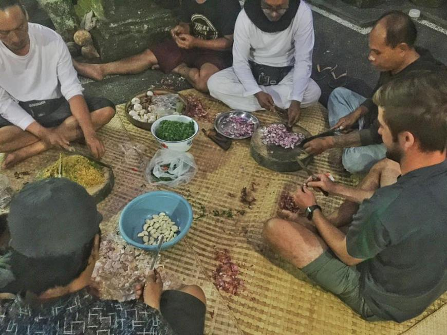 Learning how to prepare Balinese food from a group of locals