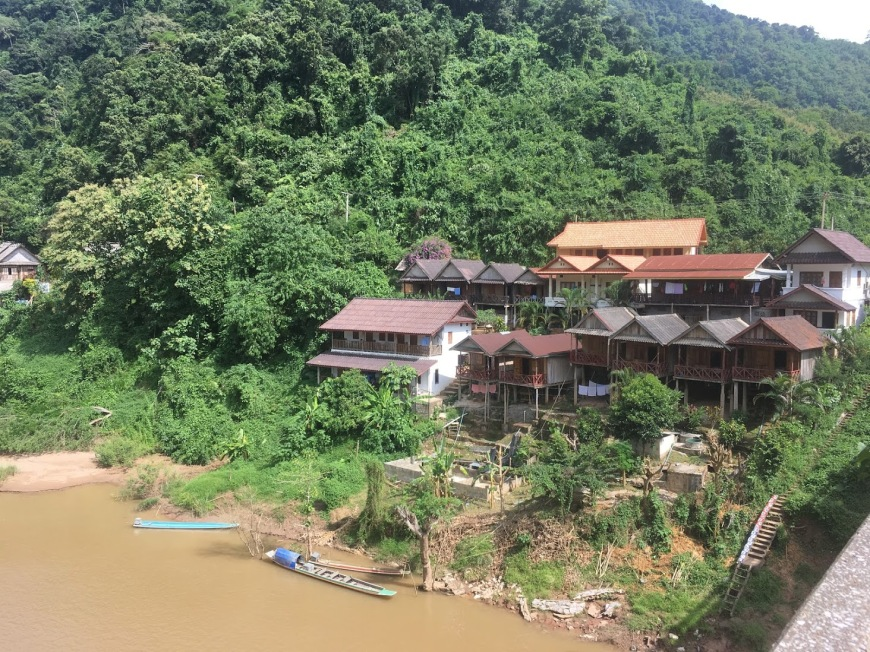 Guest houses line the hillside above the river in Nong Khiaw, Laos